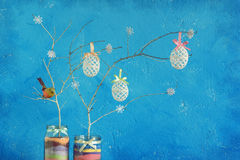 Home made Easter decoration. On the background of a blue wall Stock Photos