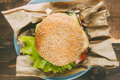 Home made fastfood burger on paper Royalty Free Stock Photos