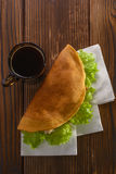 Home made fastfood with coffee on wooden table royalty free stock photography