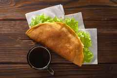 Home made fastfood with coffee on wooden table stock photo