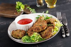 Home made Fish Cake cod, spinach and breadcrumbs. Served on plate with sauce. Cutlets from minced cod. Delicious and nutritious lunch or dinner stock photos