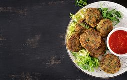 Home made Fish Cake cod, spinach and breadcrumbs. Served on plate with sauce. Cutlets from minced cod. Delicious and nutritious lunch or dinner. Top view royalty free stock images