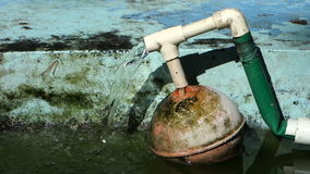 A home made float valve. To control the water level in a fish pond stock footage