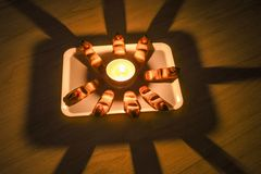 Home made freshly backed Halloween witch finger cookies on a plate with candle in the middle royalty free stock images
