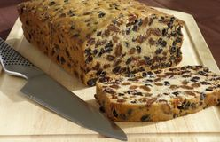 Home-made Fruit Cake on Cutting Board Royalty Free Stock Images