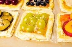 Fruit sweet pies before baking Stock Image