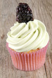 Fruity cupcake with a blackberry Royalty Free Stock Photo