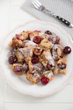 Home made German Pancakes with cherries Stock Photography
