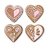 Home made gingerbread heart cookies. Homemade gingerbread heart shaped cookies with sugar icing decoration, on white background isolated royalty free stock photos