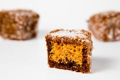 Home made gingerbread shaped- cubes with grated coconut - Sweet temptation stock photos