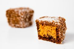 Home made gingerbread shaped- cubes with grated coconut - Sweet temptation royalty free stock photo