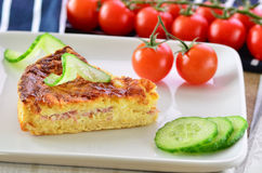 Home made ham and cheese quiche with tomatoes and cucumber Royalty Free Stock Photography