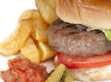 Home made hamburger with chips and pickles Stock Photo