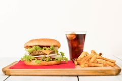 Hamburger. Home made hamburger with french fries and soft drink . close-up Royalty Free Stock Photo