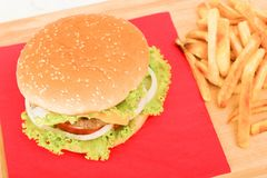 Top view on a hamburger with french fries. Home made hamburger with french fries and soft drink  , top view Royalty Free Stock Photo