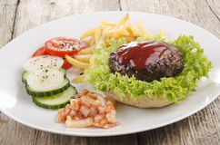 Home made hamburger on a plate Stock Photography