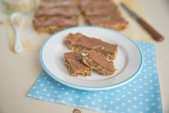 Home made healthy chocolate granola bars. On a plate royalty free stock image