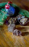 Home made Holiday truffles. Holiday truffles home made with cream and chocolate, on a cinnamon and sugar table with ornament and fir sprig decoration Stock Photos