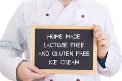 Home made lactose free and gluten free ice cream. Cook with blackboard is showing: Home made lactose free and gluten free ice cream Royalty Free Stock Image
