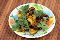 Home-made mango pickle. In white plate over wooden background Royalty Free Stock Image