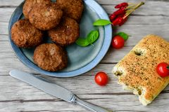 Home made   meat balls. Fried meat balls ,  hand made ciabatta bread with olive oil and spices , parmesan cheese and cherry tomatoes Royalty Free Stock Images