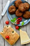 Home made   meat balls. Fried meat balls ,  hand made ciabatta bread with olive oil and spices , parmesan cheese and cherry tomatoes Royalty Free Stock Photography