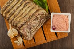 Home-made meat loaf on a wooden surface. royalty free stock photography