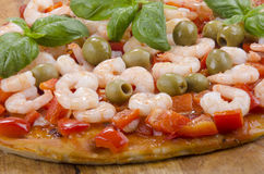 Mediterranean pizza with olives and prawns Royalty Free Stock Photography