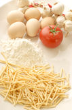 Home made noodle. With garlic, tomato and eggs Royalty Free Stock Images