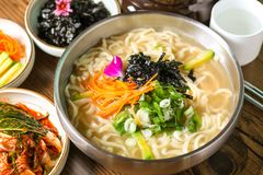 Home-made Noodle Soup garnished stock images