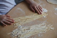 Home-made noodles and homemade dough. Making home-made noodles and home dough Royalty Free Stock Image