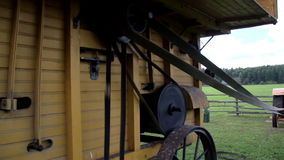 The home made old time noisy farm machine and the wheels in the machinery stock video footage