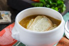 Home-made onion soup in a ceramic bowl. French cuisine stock photo