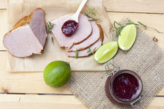 Home made organic cherry jam confiture, smoked meat and lime Stock Photos