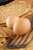 Home made pancakes, eggs and spatula. Some home made pancakes, eggs and spatula Stock Image