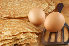 Home made pancakes, eggs and spatula. Some home made pancakes, eggs and spatula Stock Photo