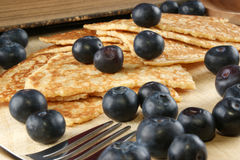 Home made pancakes with fresh blueberries. Some home made pancakes with fresh blueberries stock photography