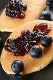 Home made pancakes with fresh blueberries. Some home made pancakes with fresh blueberries stock photo