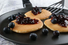 Home made pancakes with fresh blueberries. Some home made pancakes with fresh blueberries royalty free stock image