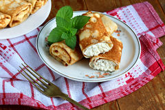 Home made pancakes. Rolled pancakes with cottage cheese close up Stock Image