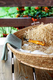 Home made pasta. Traditional basket filled with tagliatelle royalty free stock photos
