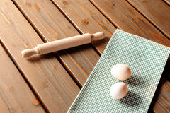 Home made pasta. Eggs and rolling pin on a very peculiar set stock photos