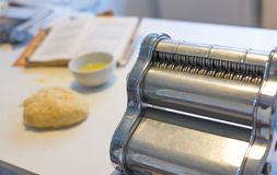 Home made pasta with old Machine and Old recepie book. Royalty Free Stock Photos