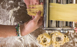 Home made pasta. Preparing home made pasta with pasta maker stock image