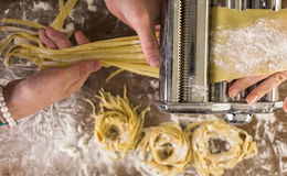 Home made pasta. Preparing home made pasta with pasta maker royalty free stock photo