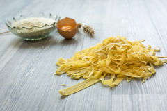 Home made pasta on wooden ground. Stock Photo