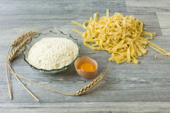 Home made pasta on wooden ground. Stock Images