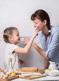 Home-made pastries: Mom and daughter are fooled and molded from dough. Portrait Royalty Free Stock Images