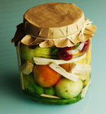 Home made pickles in jar. Home made pickles, tomatoes horseradish red pepper Royalty Free Stock Image