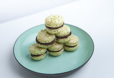 Home-made pistachio macaroons on plate Royalty Free Stock Photo